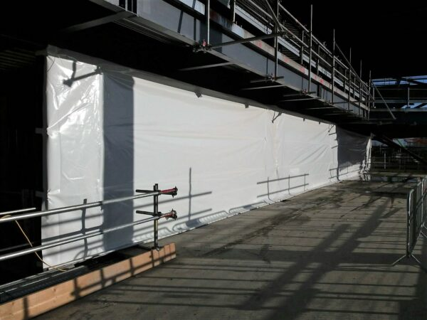 The benefits of adding waterproof temporary screens to your next building project